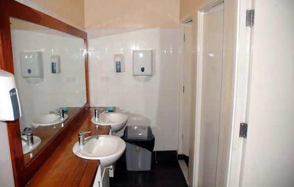 Clean, well serviced dorm bathrooms